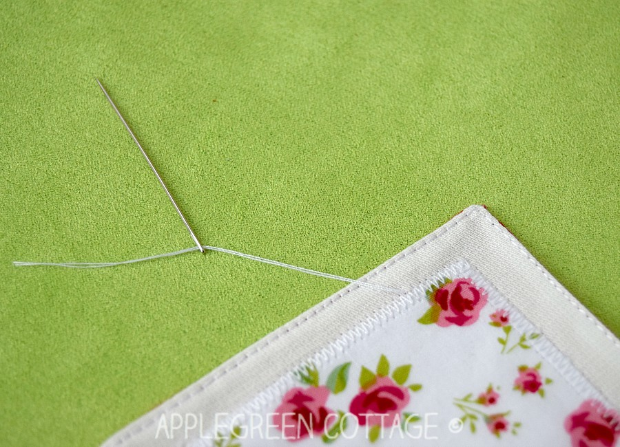using needle to bury thread ends