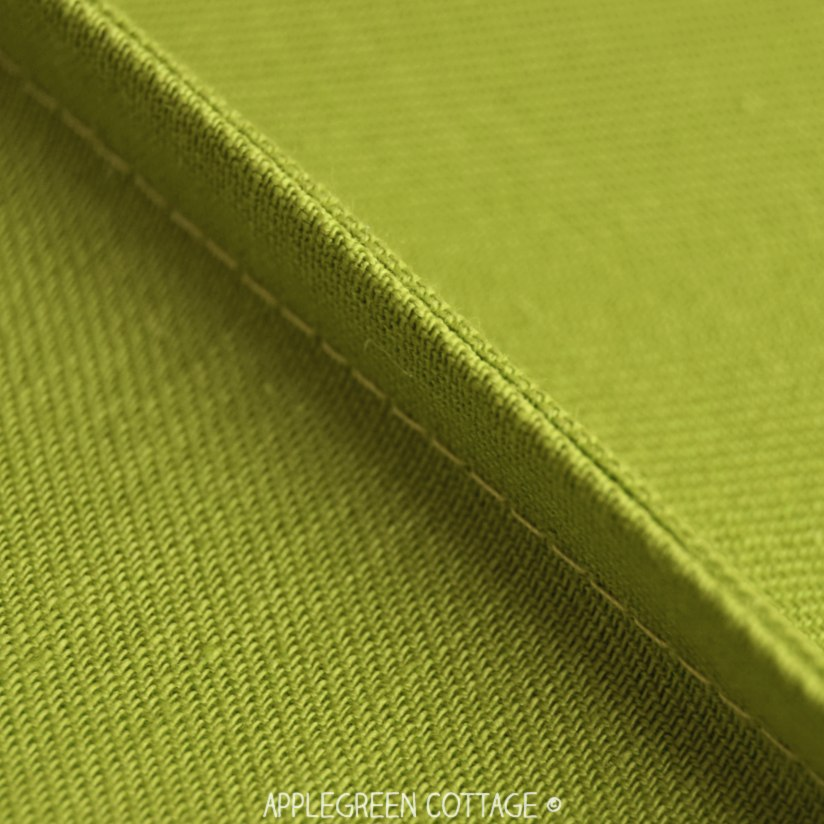 green upholstery fabric sewn with french seam