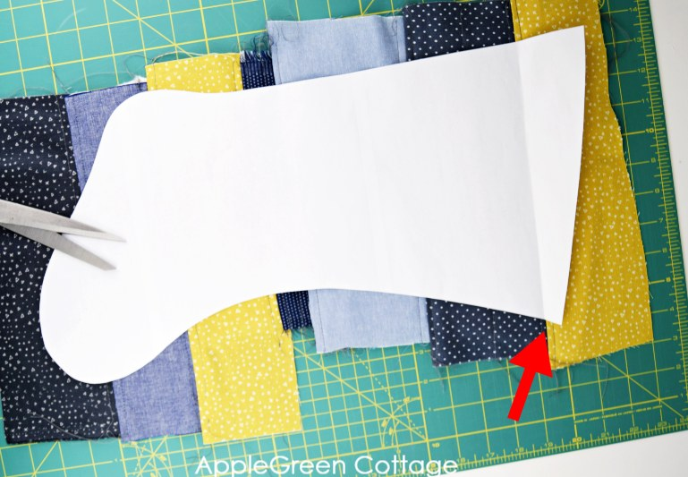 printed stocking pattern placed on the fabric to be cut