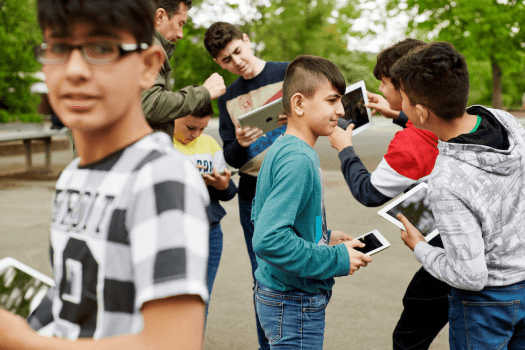 This image shows children using iPads to talk