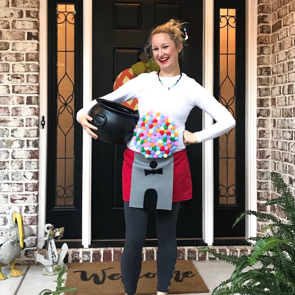 Pregnant woman in a gumball machine halloween costume