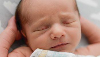 Newborn asleep in his crib