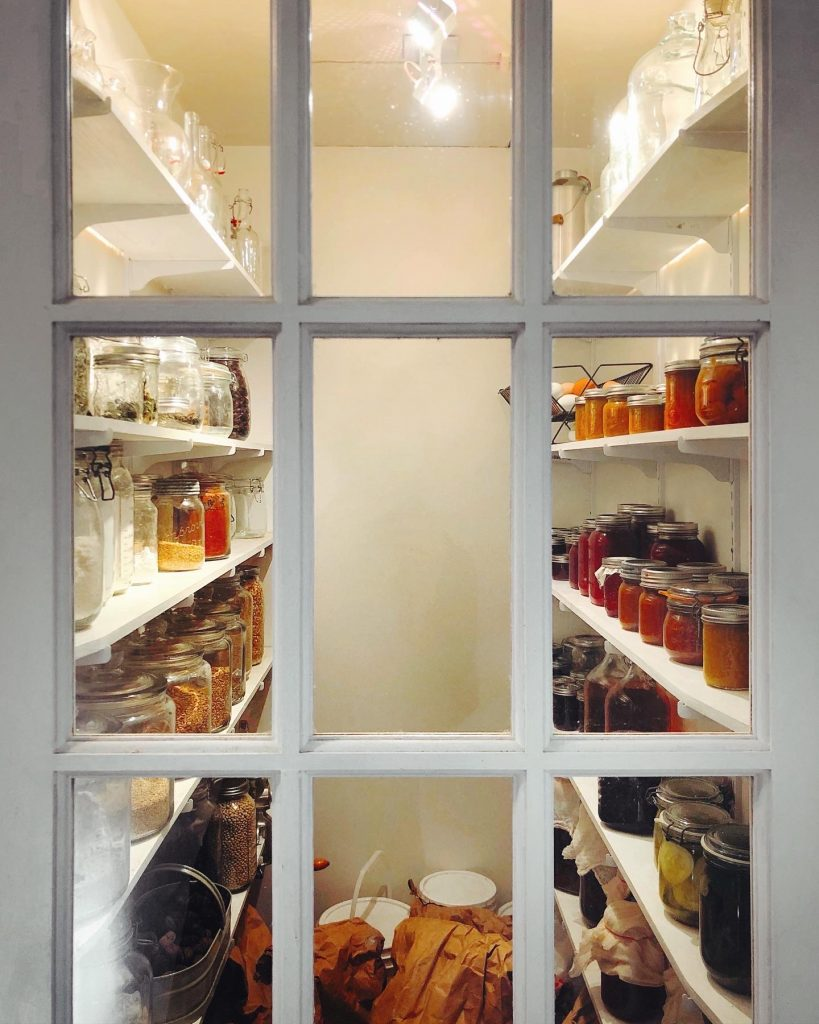 looking through the glass door into the pantry.