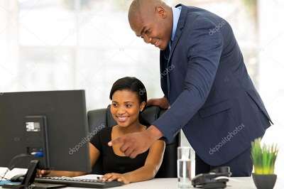 man teaching a lady in imo state