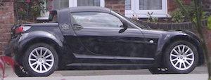 Image of a black Smart Roadster