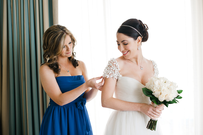 bridesmaid-fixing-dress