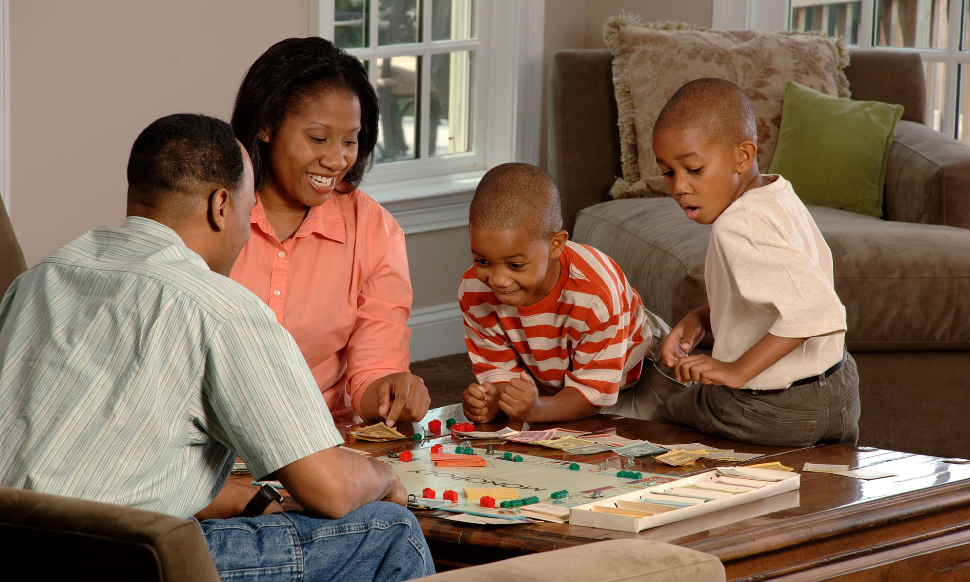 African American family playing a board game