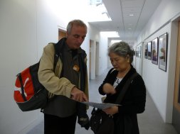 Dariusz and Keiko check the schedule.