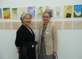 Keiko and April in front of the exhibition