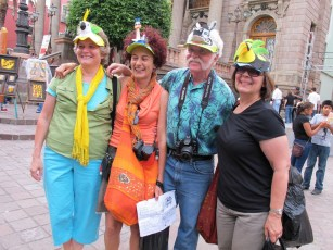 showing off the hats in front of Teatro Juarez