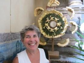 Debra with corn husk altar decoration