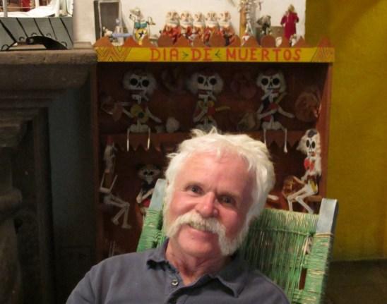 Mike in front of a Dia de Muertos display