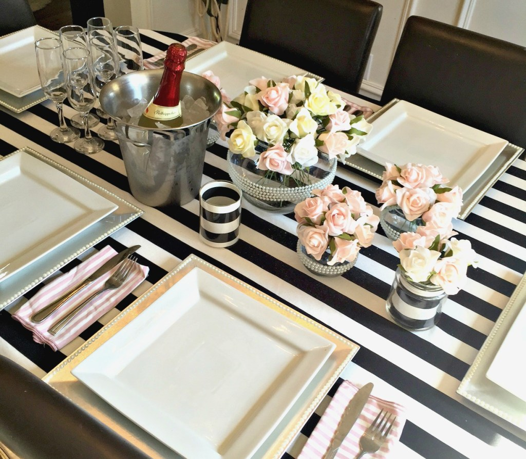 How to set a pretty tablescape for graduation, a wedding, bridal shower, or birthday party using black and white with pink roses at apurdylittlehouse.com