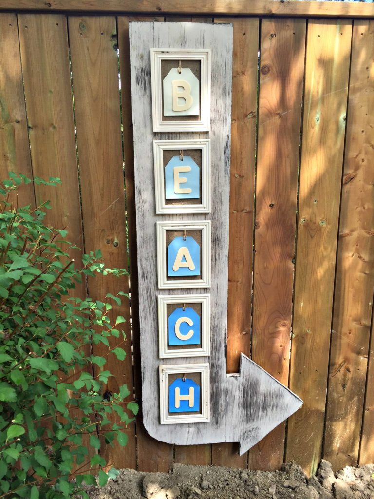 Coastal Beach Arrow Sign made using items from the dollar store and scrap wood for the #30dayflip Dollar Store Flip Challenge at apurdylittlehouse.com