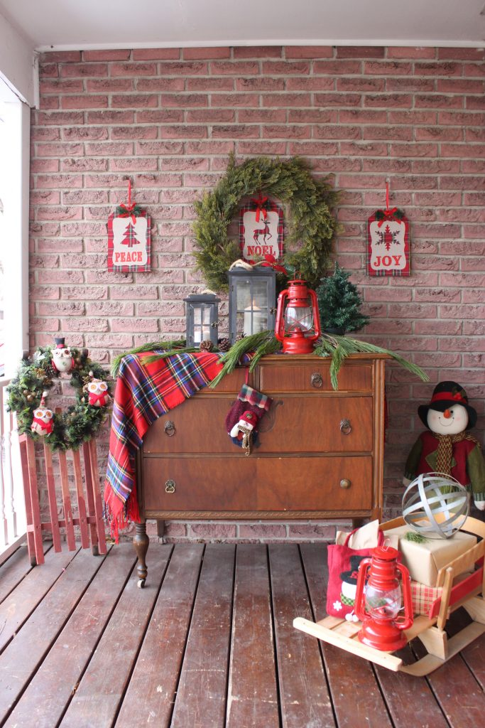 Christmas Front Porch using an old antique dresser and sleds. See all the details at apurdylittlehouse.com