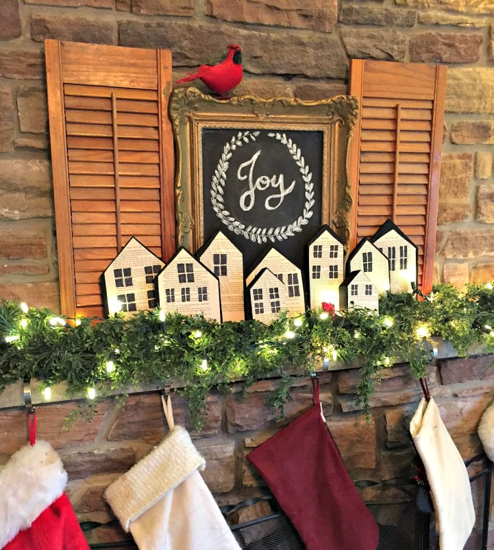 Christmas Home Tour featuring fireplace mantel with wood block houses and a chalkboard at apurdylittlehouse.com