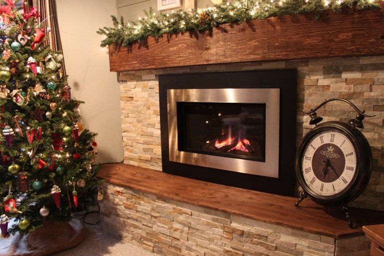 Christmas Home Tour featuring our new natural stone fireplace with shiplap on top and a faux barnboard mantel. See more at apurdylittlehouse.com