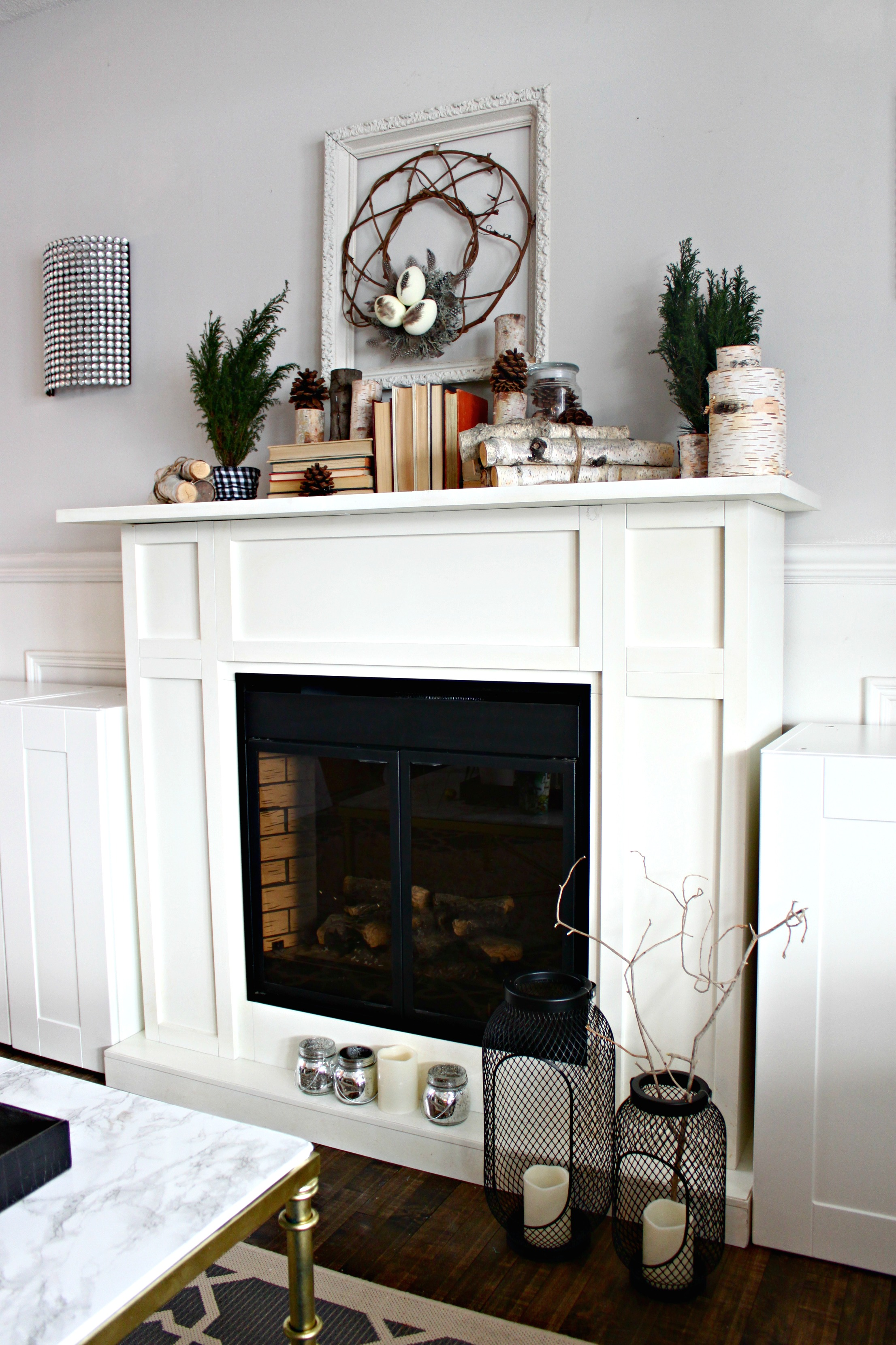 Easy DIY Winter Wreath and how I decorated my mantel for the winter months. A white electric fireplace can work well for a winter theme.