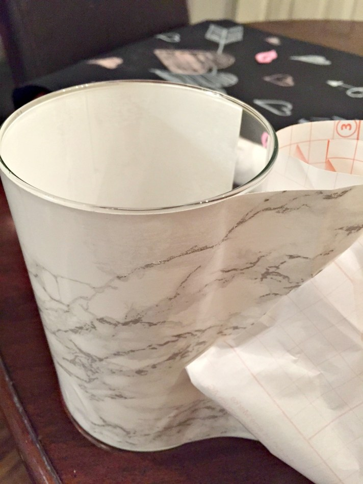 Faux Marble Vase. Find out how to make a fake marble vase using a glass vase and contact paper.