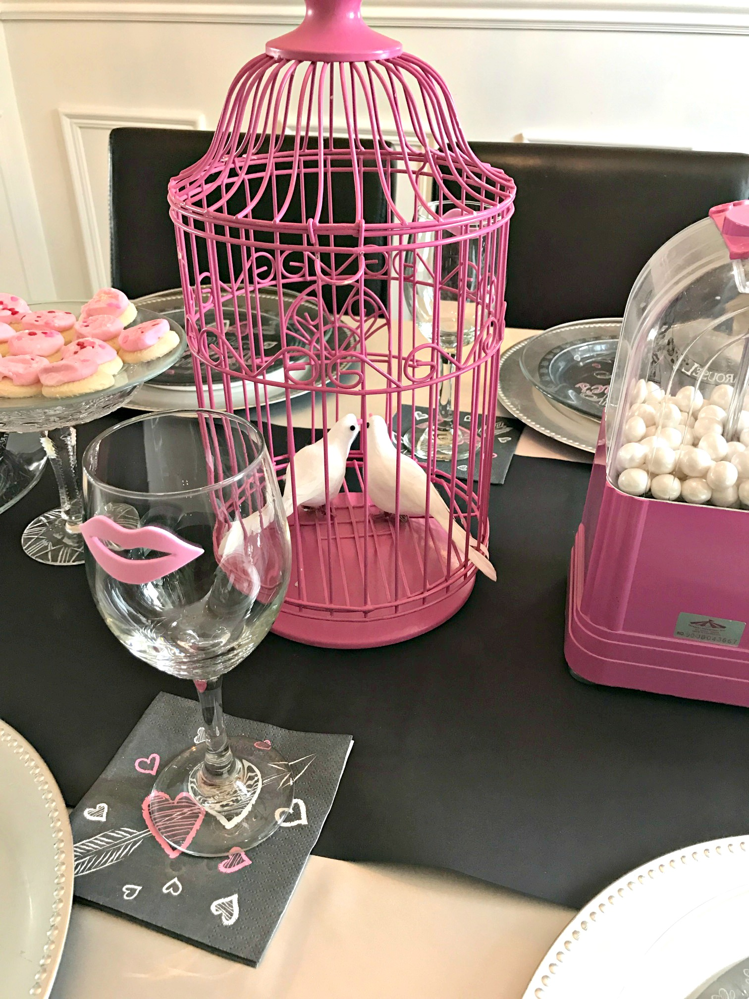 Valentine's Day Table setting using pink and black with chalkboard accents and a candy bar