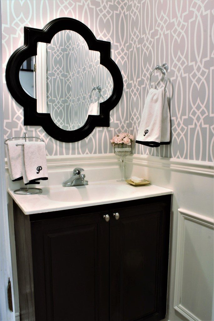 Powder Room Update - Week 5 Final Reveal. Wallpaper in Powder room, grey and white bathroom, DIY art and monogrammed towels. apurdylittlehouse.com.