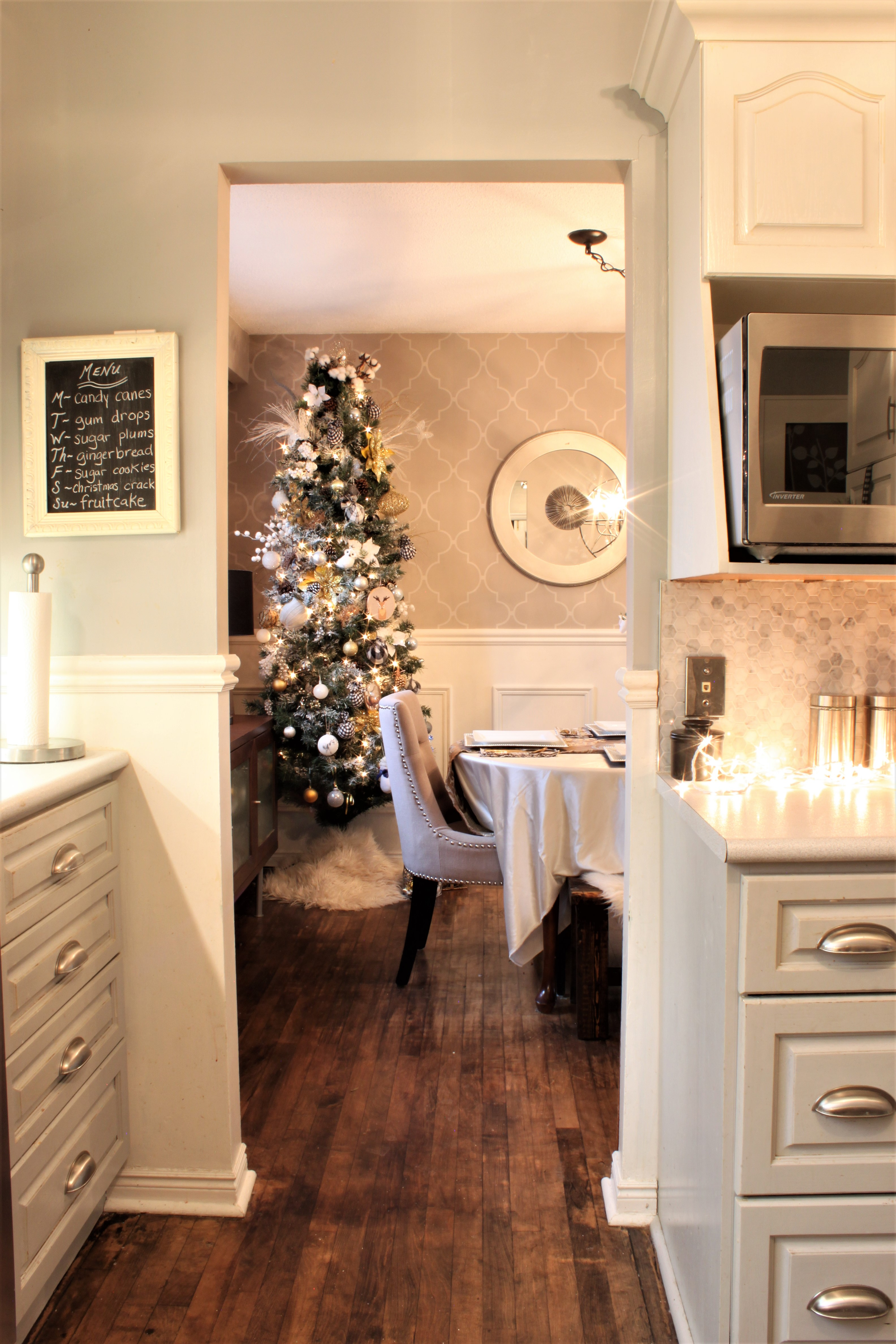 Neutral Christmas Home Tour Decor Dining Room from Kitchen