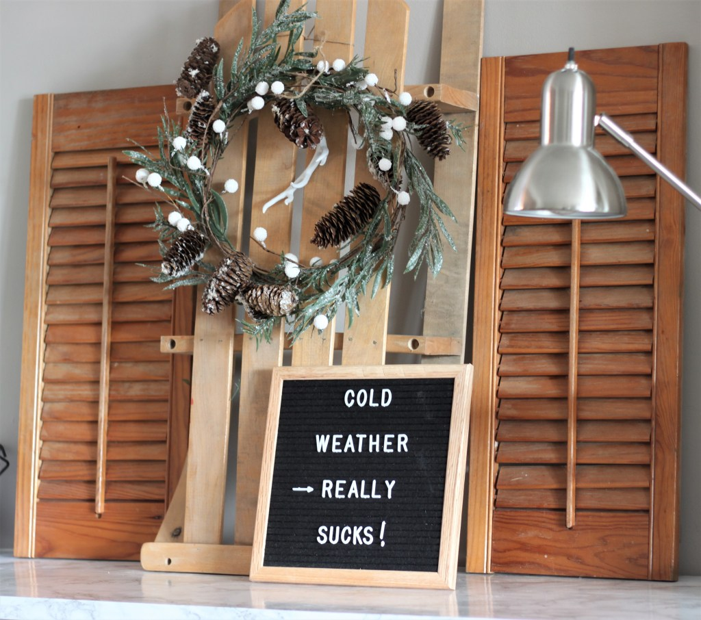 Old Fashioned Sled repurposed into winter and christmas decor