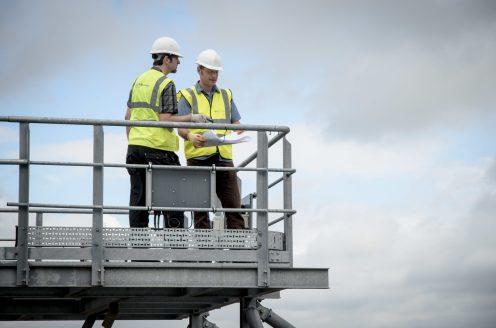 Men in work clothes on platform