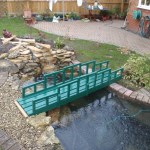 Pond re-line Bristol: Pond surrounds of gravel and pebble