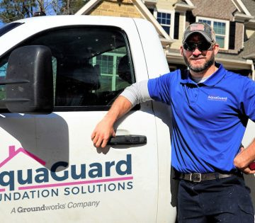 AquaGuard crew member in front of truck