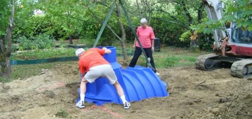 Pose d'une cuve enterrée de récupération d'eau de pluie