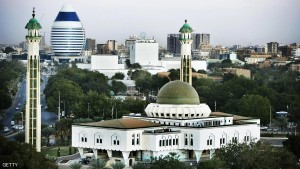 KHARTOUM, SUDAN - JANUARY 9, 2007: A general view of the city center and the As Sayed Ali Mosque (R) and an innovative building (L) shaped like a boat sail that will host a new hotel built by a Lebanese company are seen on January 9, 2007 in Khartoum, Sudan. Khartoum, the capital of Sudan, lies at the point where both the Blue and the White Nile converge and in recent years has been best known for the political turmoil which stems from it's government. Within this war torn city lays the largest commercial construction site in Africa known as Al Mogran Project, which spans 1,500 acres, at a place known as Alsunut from the name of its nearby forest. With the help of foreign Chinese workers, the Sudanese Alsunut Development Company LTD, owned by the Dal Group - the first industrial group of the country, are working furiously to develop a new Dubai which is to become the commercial and financial headquarters of Islamist East Africa. The site is to include multiple modern office towers, duplexes and golf courses. The project is to cost USD $4billion and is scheduled to house both the headquarters of the Greater Nile Petroleum Operating Company as well as Petrodar, both of which are Chinese, Malaysian, Indian and Sudanese joint venture oil companies and is due to be complete within the next five to fifteen years. (Photo by Marco Di Lauro/Getty Images)
