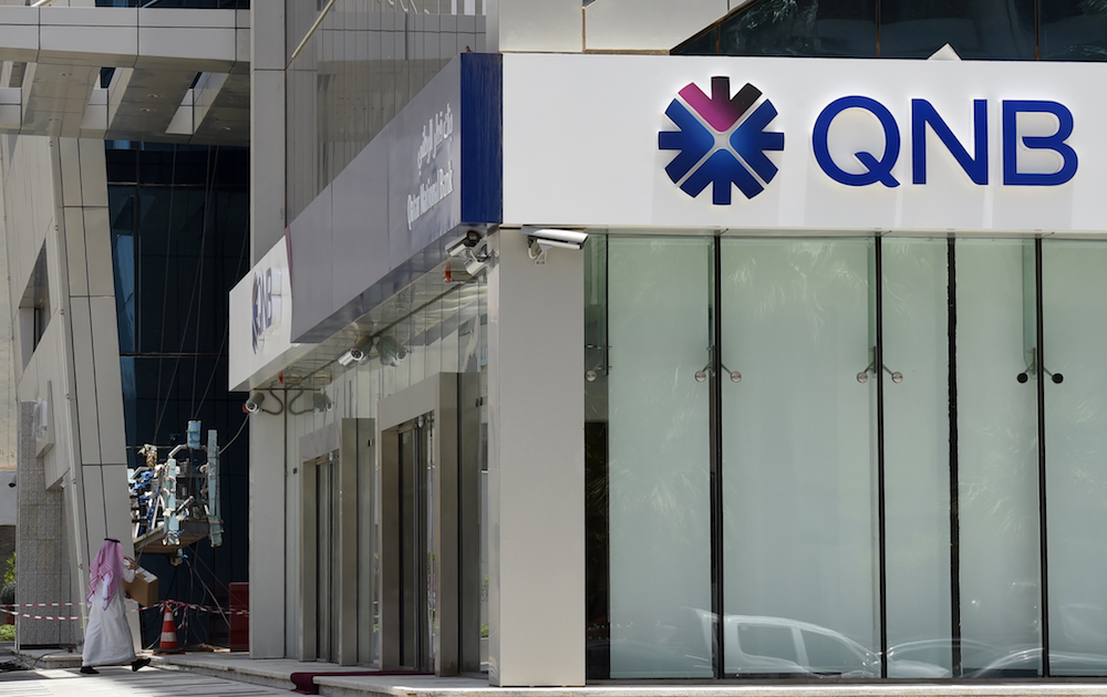 Photo of Qatar's top bank Q2 profit slides over virus