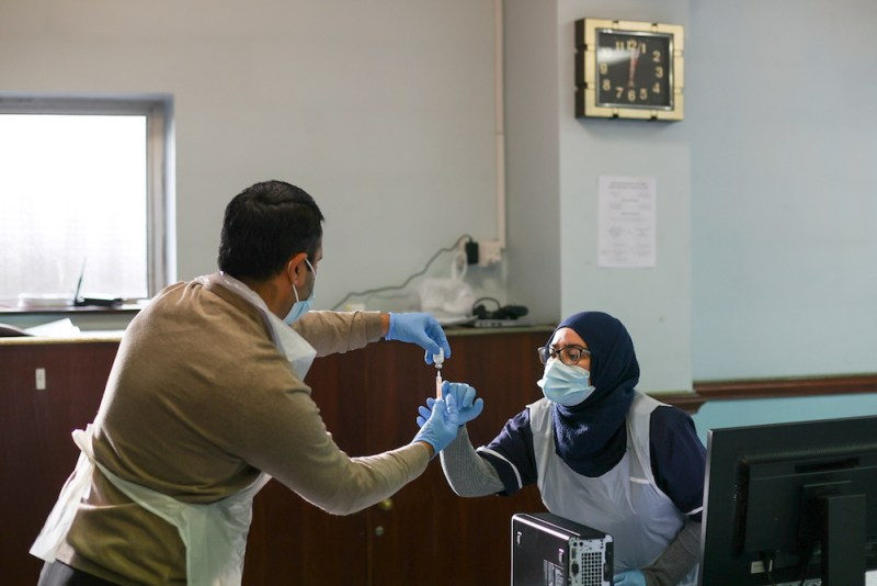 Medical staff prepare a coronavirus disease (COVID-19) vaccine dose, at the Al-Abbas Islamic Centre, in Balsall Heath, Birmingham, Britain, January 21, 2021. (Reuters)