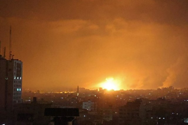 An explosion lights the sky following an Israeli air strike on Beit Lahia in the northern Gaza Strip on May 14, 2021. (File/AFP)
