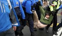 An anti-Trump protester is dragged away by police from a public access point to the National Mall. (Photo by Getty Images)