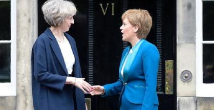 Britain's Prime Minister Theresa May (L) is greeted by Scotland's First Minister Nicola Sturgeon (R) as she arrives for talks at Bute House in Edinburgh on July 15, 2016. (photo by AFP)