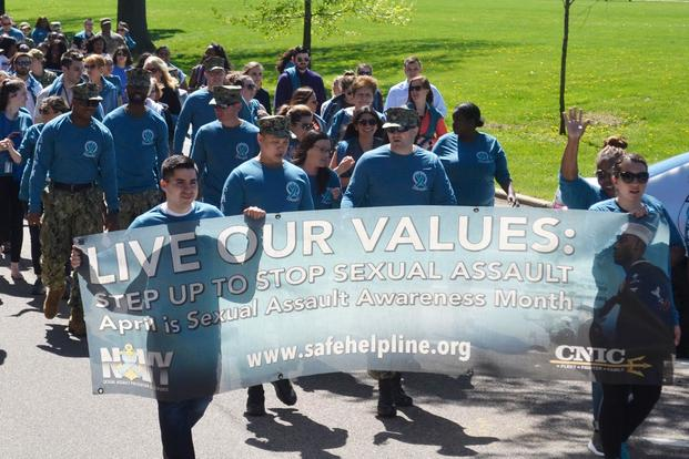 "s of Sexual Assault Awareness and Prevention Month from NSA Philadelphia and its tenant commands create a ""sea of teal"" on their awareness walk across April 23, 2019 in Philadelphia. (Defense Logistics Agency/John Dwyer)"