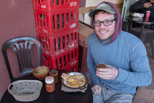 man with tea and berber omelette, Morocco food, arboursabroad