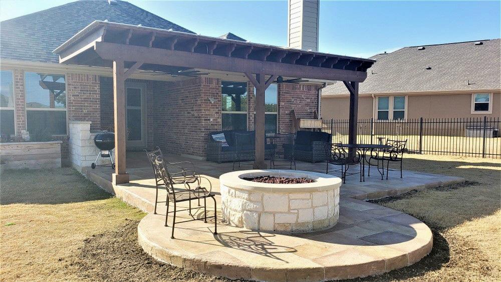 custom patio extension features shade pergola and amenities