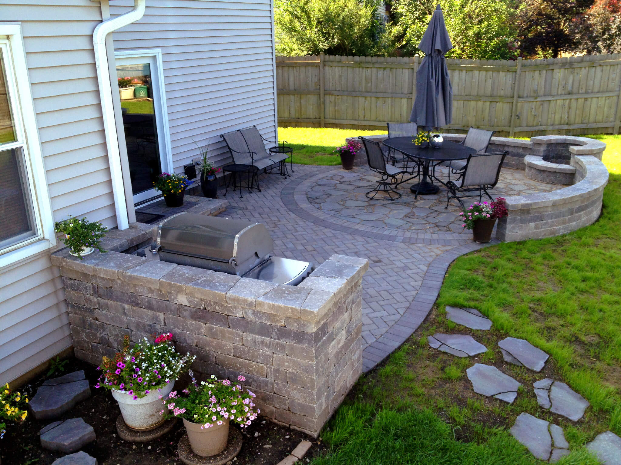 should i use concrete or pavers for my