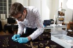 Anglo-Saxon specialist Chris Fern has examined every fragment from the Staffordshire Hoard, grouping together fragments that came from the same artefact, and making stylistic links. Photo: Birmingham Museums