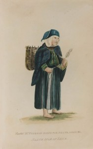Mary McPherson carrying peats, aged 82.