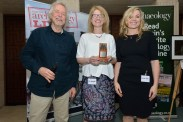Nora Bermingham and Caitriona Moore receive the award for Rescue Dig of the Year 2016 from Julian Richards. L-R: Julian Richards, Nora Bermingham, Caitriona Moore. Aerial-Cam / Current Archaeology