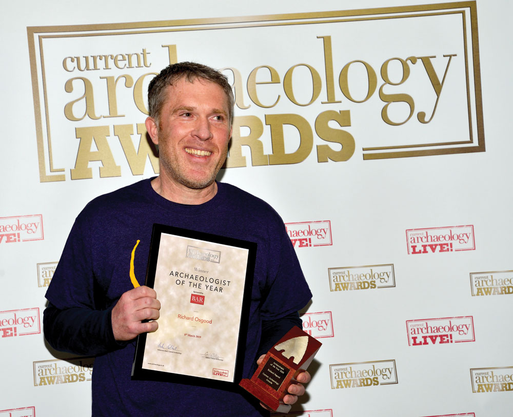 Richard Osgood collects the Archaeologist of the Year 2019 award.