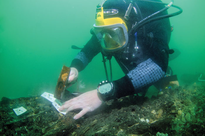 Garry Momber from the Maritime Archaeology Trust tagging parts of the platform for excavation.
