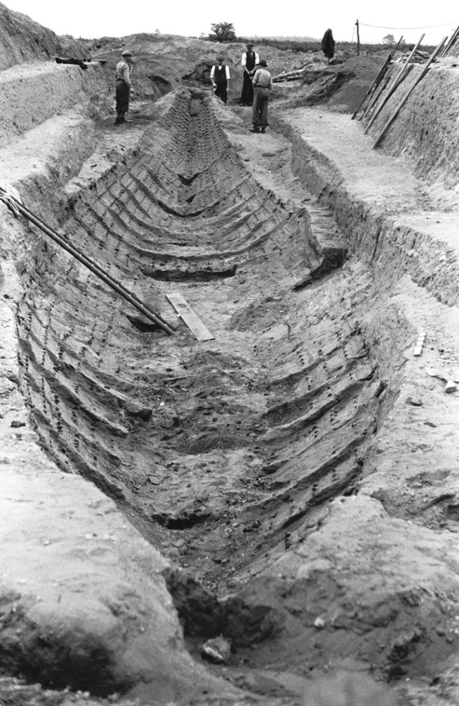 Trench with remains of the Mound 1 ship, although the timbers had decayed in the acidic Suffolk soil, its outline could still be clearly seen. The vessel measured 27m in length and could have accommodated 40 oarsmen.