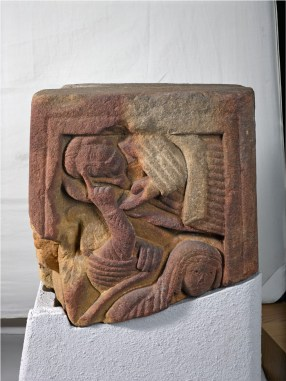 The ornate Anglo-Saxon Rothbury Cross is finely carved with a number of scenes, including the raising of Lazarus from the dead as seen on this fragment of the cross shaft.