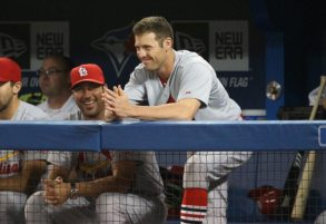 Hitting coachJohn Mabry chats with Peter Bourjos during a game in Toronto. (Photo by Tom Szczerbowski/Getty Images)