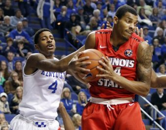 Illinois State's DeVaughn Akoon-Purcell, right, pulls down a rebound next to Kentucky's Charles Matthews (4) during the first half of an NCAA college basketball game Monday in Lexington, Ky. (AP Photo/James Crisp).